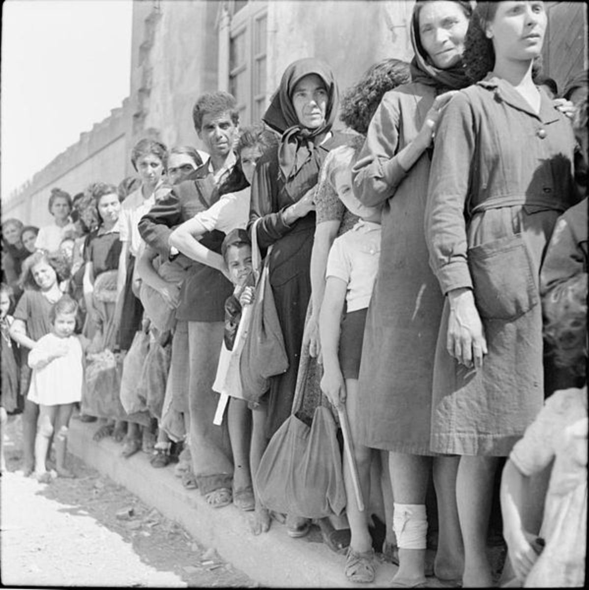 The Liberation of Rhodes, 1945. Civilians on the island of Rhodes queue to get their ration books from the British military authorities.
