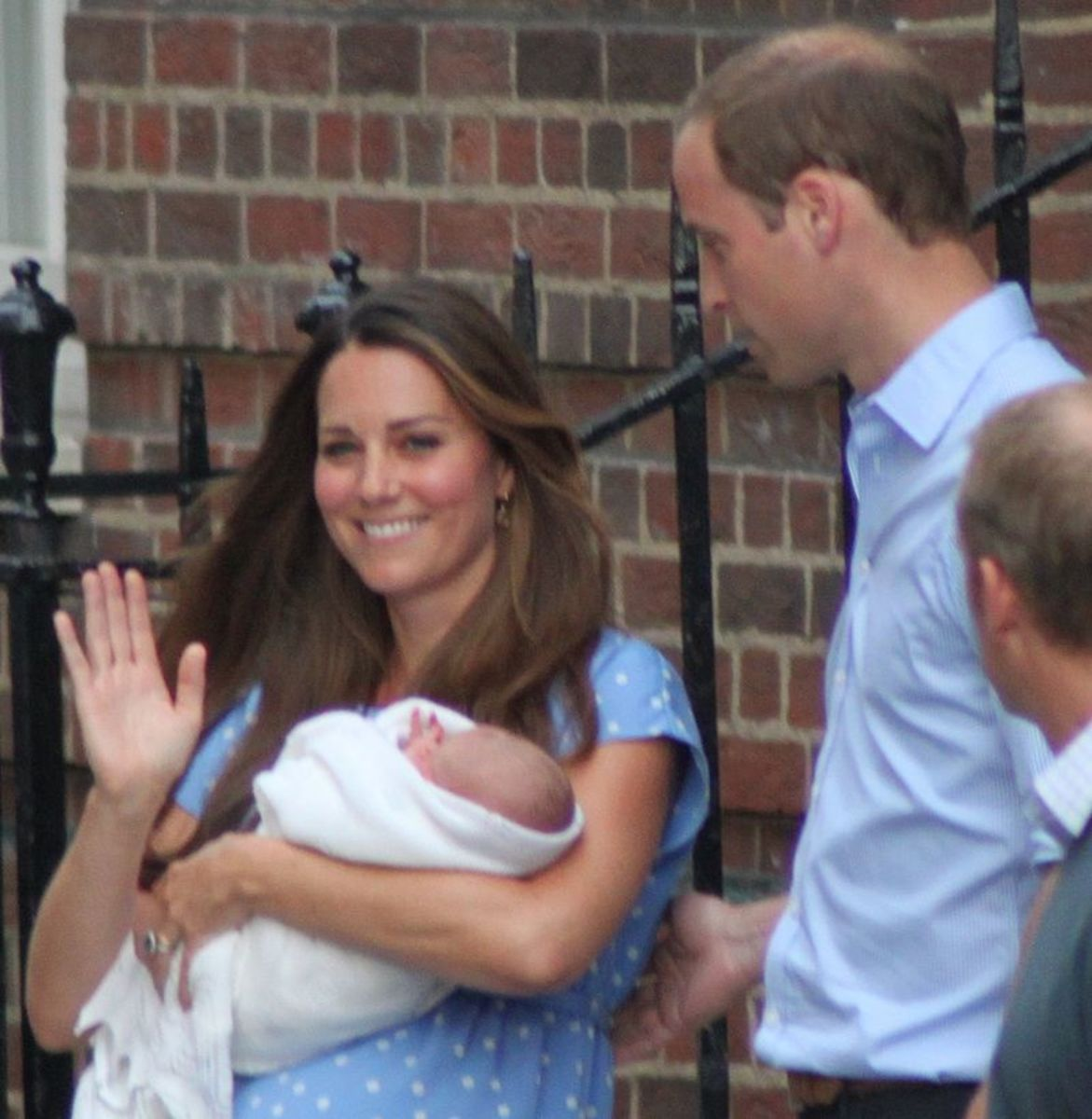 Prince William and Kate Middleton leave hospital with firstborn in 2011.