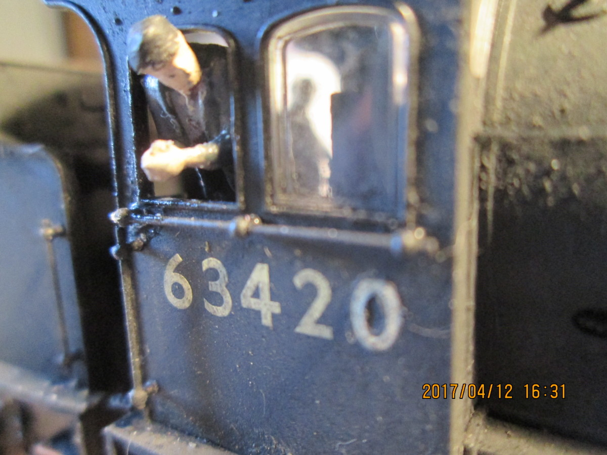 The driver looks ahead for the starter signal (figure from the ModelU range, engine is a Hornby Q6 0-8-0 weathered to look care-worn and used)