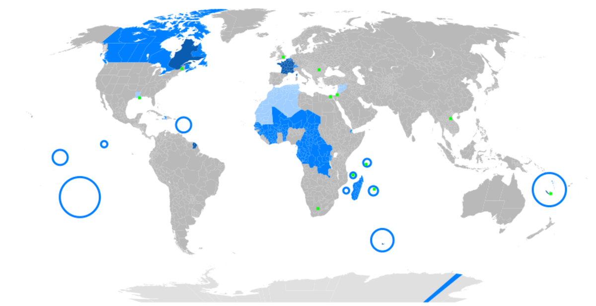 Legend: Dark blue is maternal language, blue is official language, light blue is secondary language, and green is minority language.