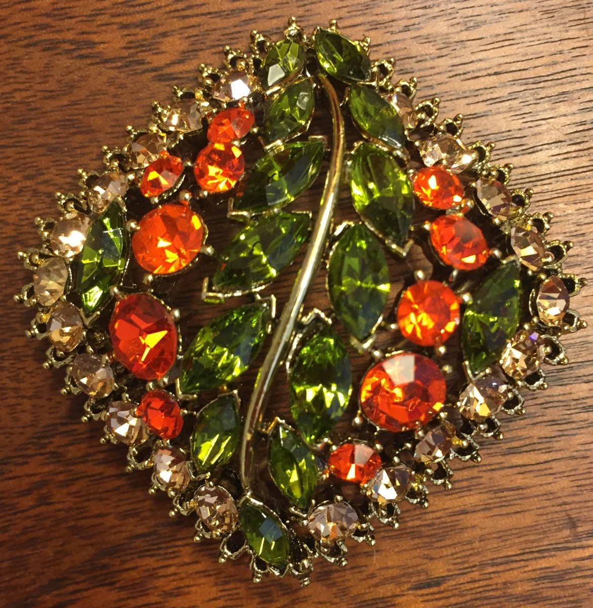 Brooch with colored rhinestones set in goldtone metal, 1950s-60s