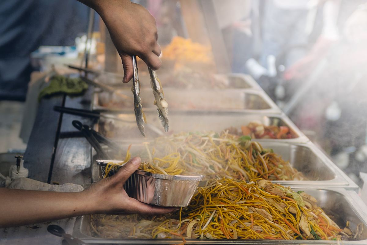 Longevity Noodles Being Sold at the Street (Photo by James Sutton on Unsplash)