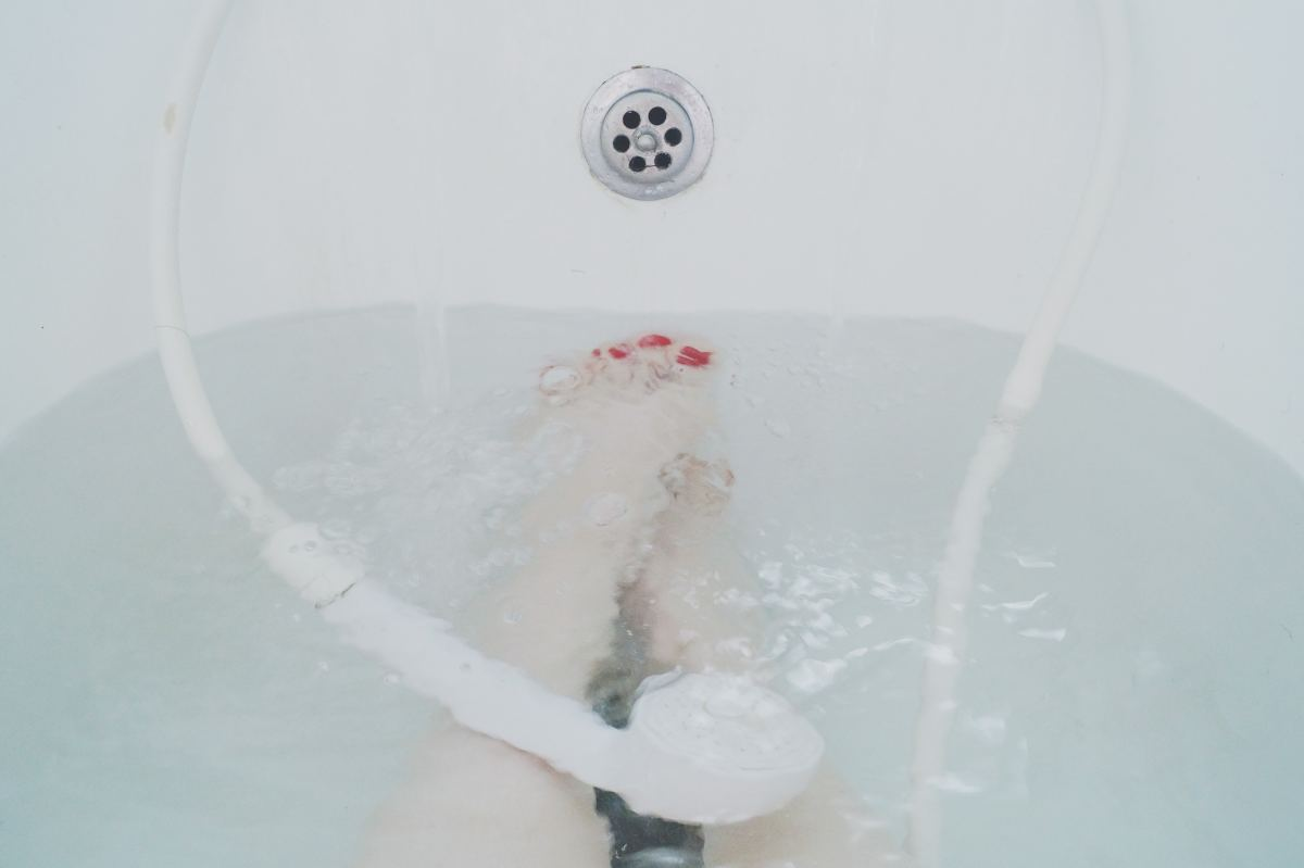 Taking a Shower (Photo by Karla Alexander on Unsplash)