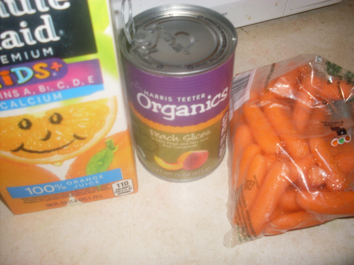 juice, carrots and peaches : prepping ingredients for the orange, peach and carrot smoothie