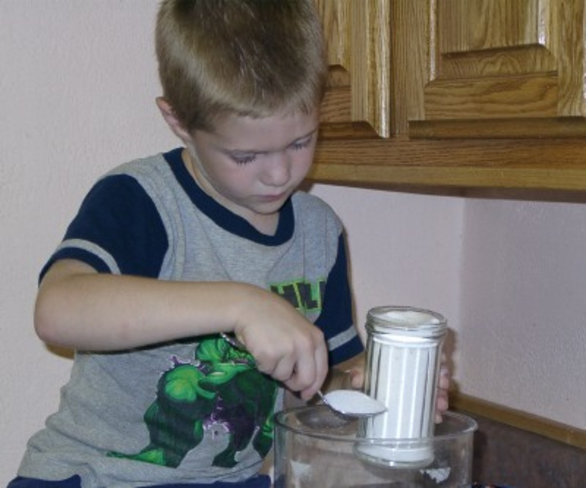 My great-nephew carefully measuring out sugar for a recipe.