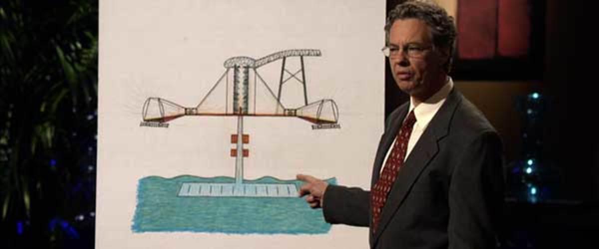 Mark Sullivan shows off a diagram of his Sullivan Generator.