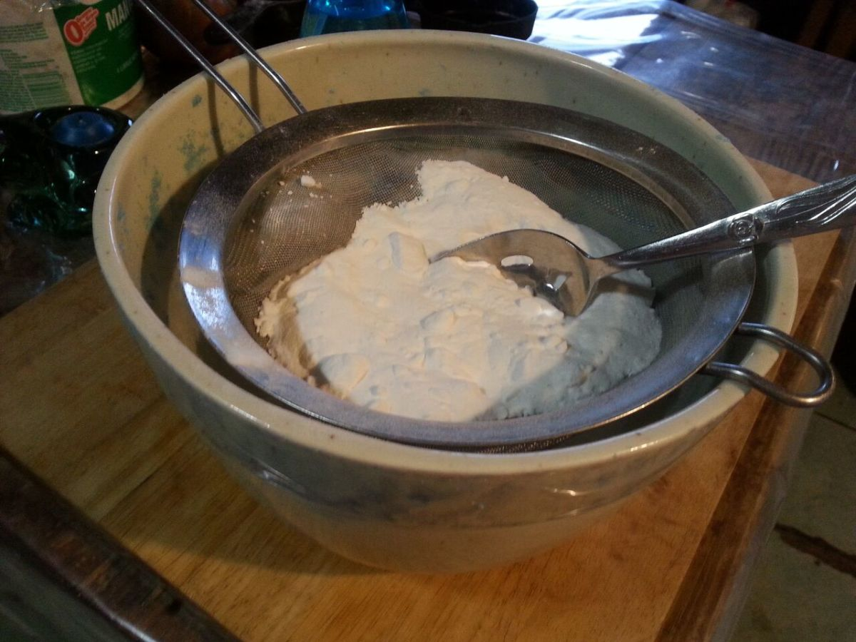 Using a strainer to sift baking soda