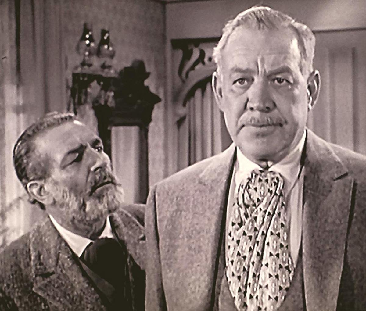 """Frank  McGrath (left)  and Ward Bond. Notice the contrast in their faces. McGrath was """"Charlie Wooster"""" and Bond was """"Major Seth Adams"""" on Wagon Train."""