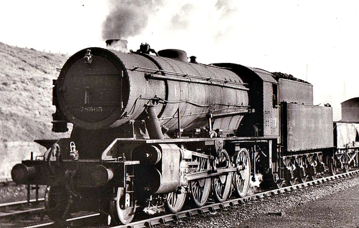 Robert Riddles' War Department 'Austerity' 2-8-0 was classed as 8F like the Stanier design.  No 78565 is seen here on shed between duties. A large number was bought by the LNER, carried into BR ownership with prefix '9' to the number