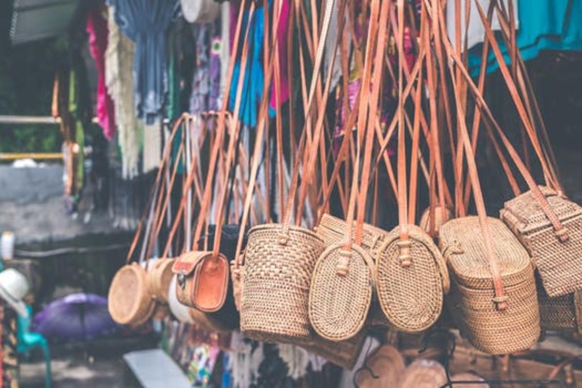 Wicker bags hanging in a farmers market.
