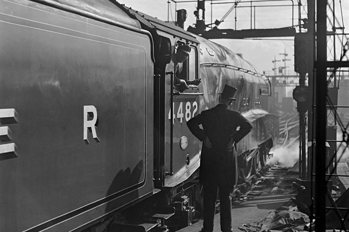 A4 No. 4482 'Golden Eagle' awaits the 'off' at King's Cross with the 'Flying Scotsman' service - top-hatted stationmaster in attendance