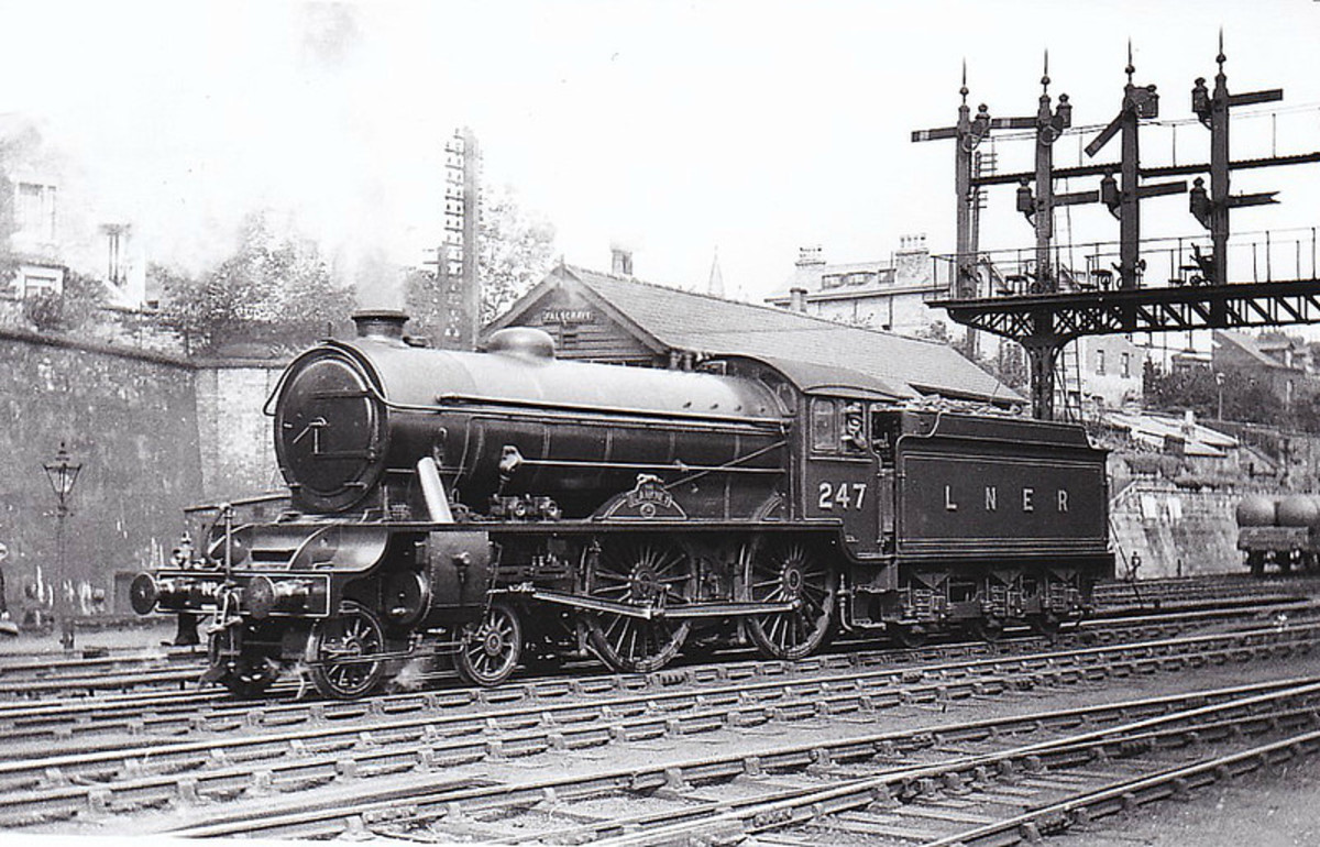 A further development of the D49 was Class D49/2 named after fox hunts in he LNER area. No. 247 'The Blankney' pf Hull Botanic Gardens shed is seen here by Falsgrave signal cabin, Scarborough
