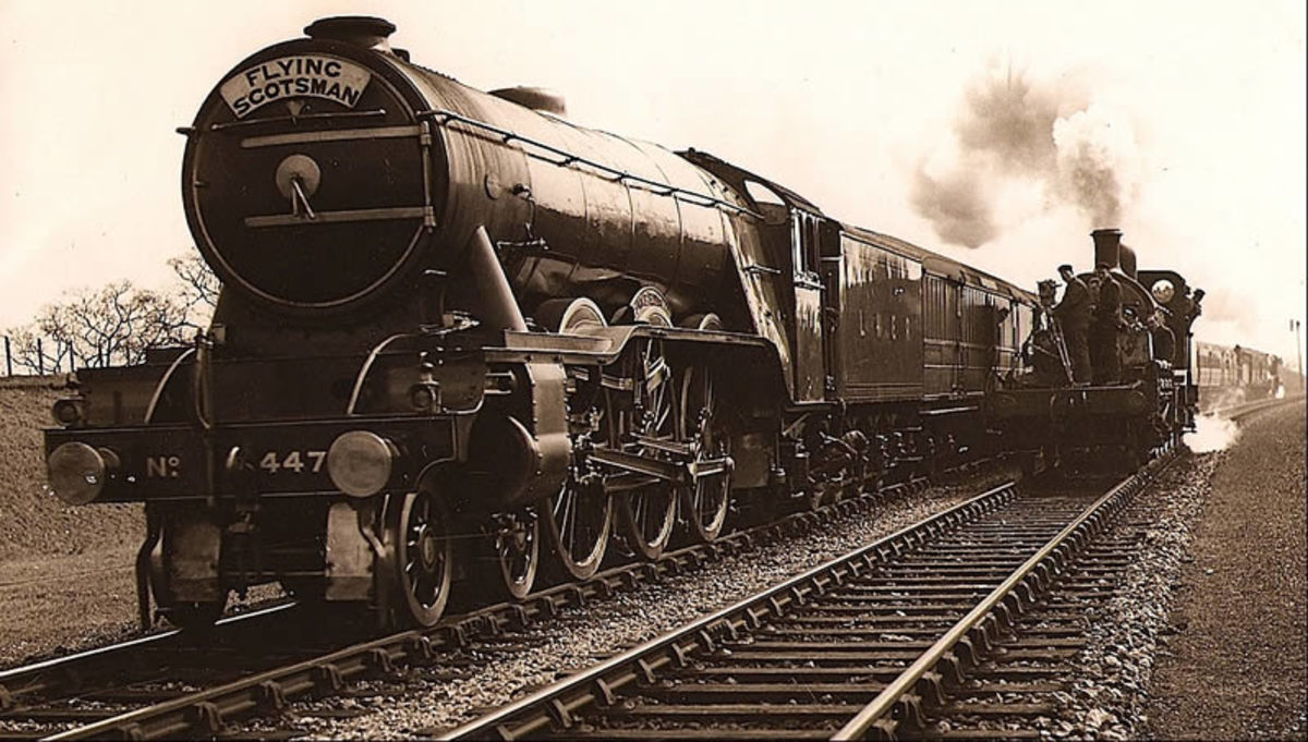Every schoolboy's icon - 4472 'Flying Scotsman' is seen in 1929 with a rake of carriages working an express service - now in national ownership through the National Railway Museum's intervention after she was put up for sale 1996
