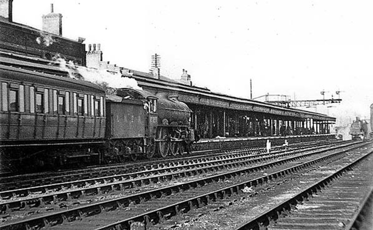 A 'Sandringham' class B17 with Gresley side corridora passenger stock at Cambridge, possibly arrived from London