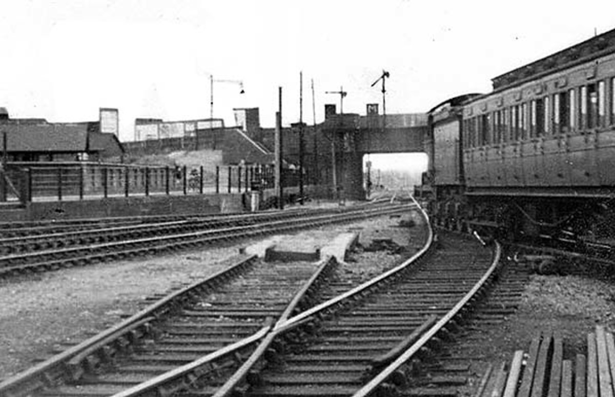 An East Anglia local passenger train leaves Cambridge with pre-Grouping stock