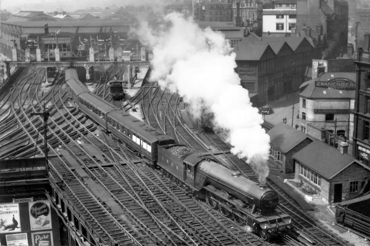 Newcastle-upon-Tyne, A1 2577 'Night Hawk' is seen from the Norman keep with a northbound express rattling over the (in)famous 'diamonds'