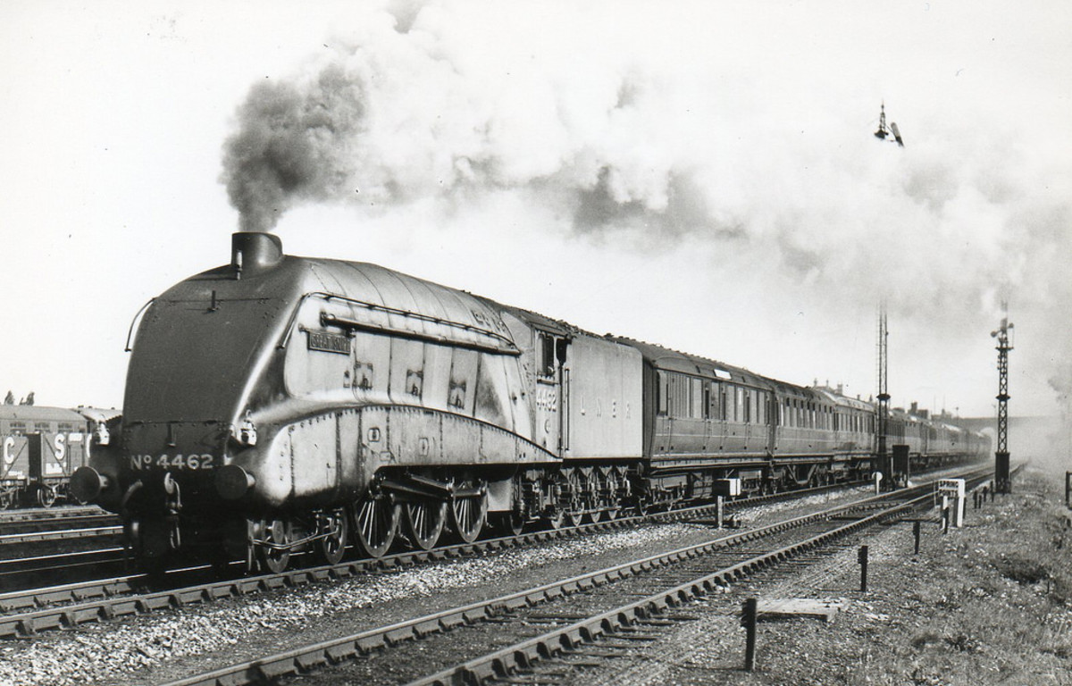Class A4 4462 'Great Snipe' brings an express through New Southgate in the north London suburbs during the 1930s