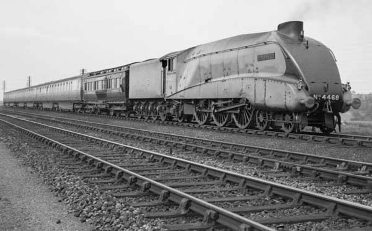 Class A4 4468 'Mallard' passes Barkston Junction on the ECML near Grantham in Lincolnshire with the York dynamometer carriage and one of the Silver jubilee sets on 3rd July 1938 to tackle her record-breaking run