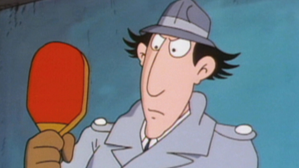 Inspector Gadget is shown looking at his ping pong racket in this photo.