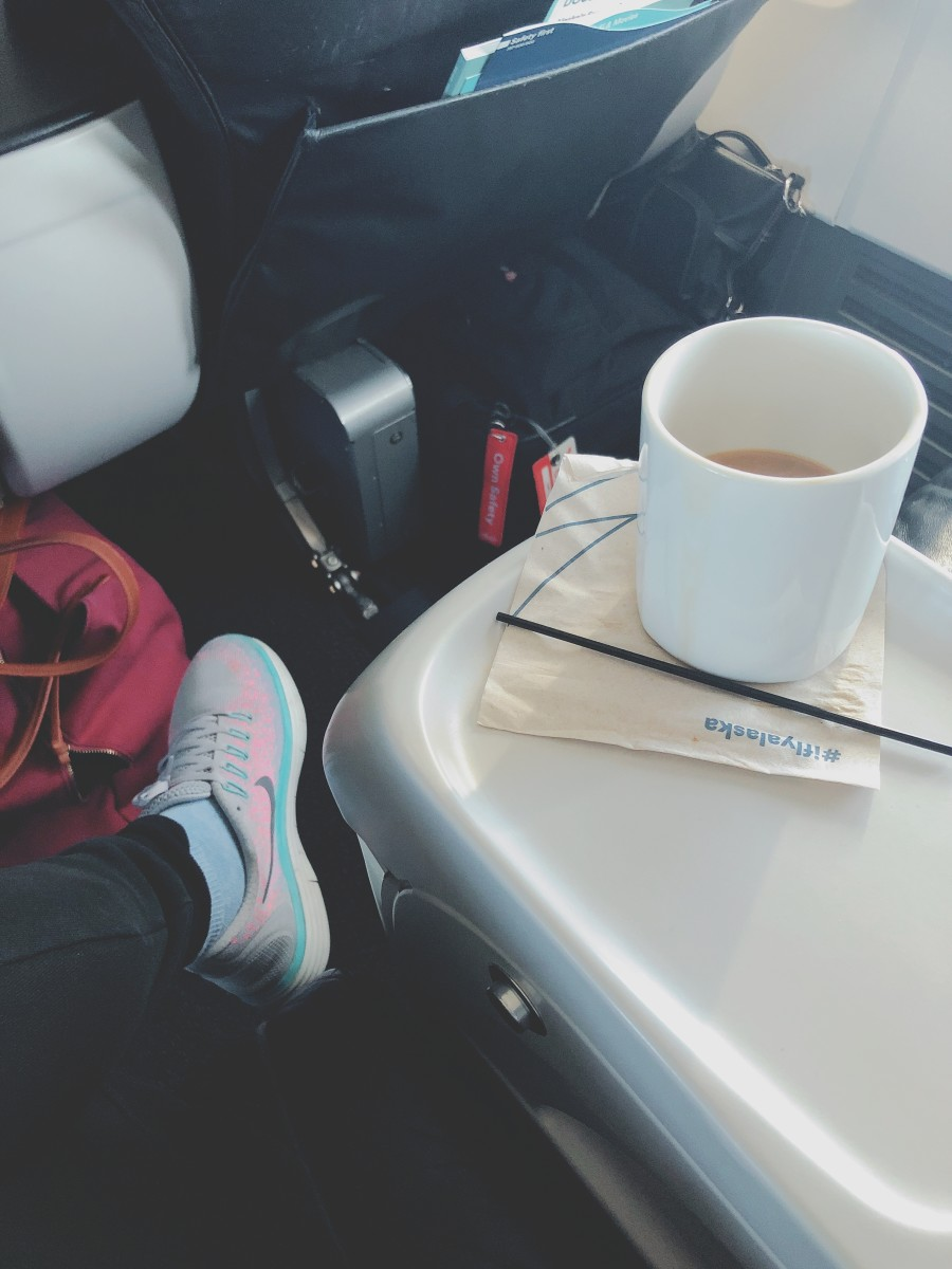 Try to get comfy on a flight by choosing comfort shoes and clothes.