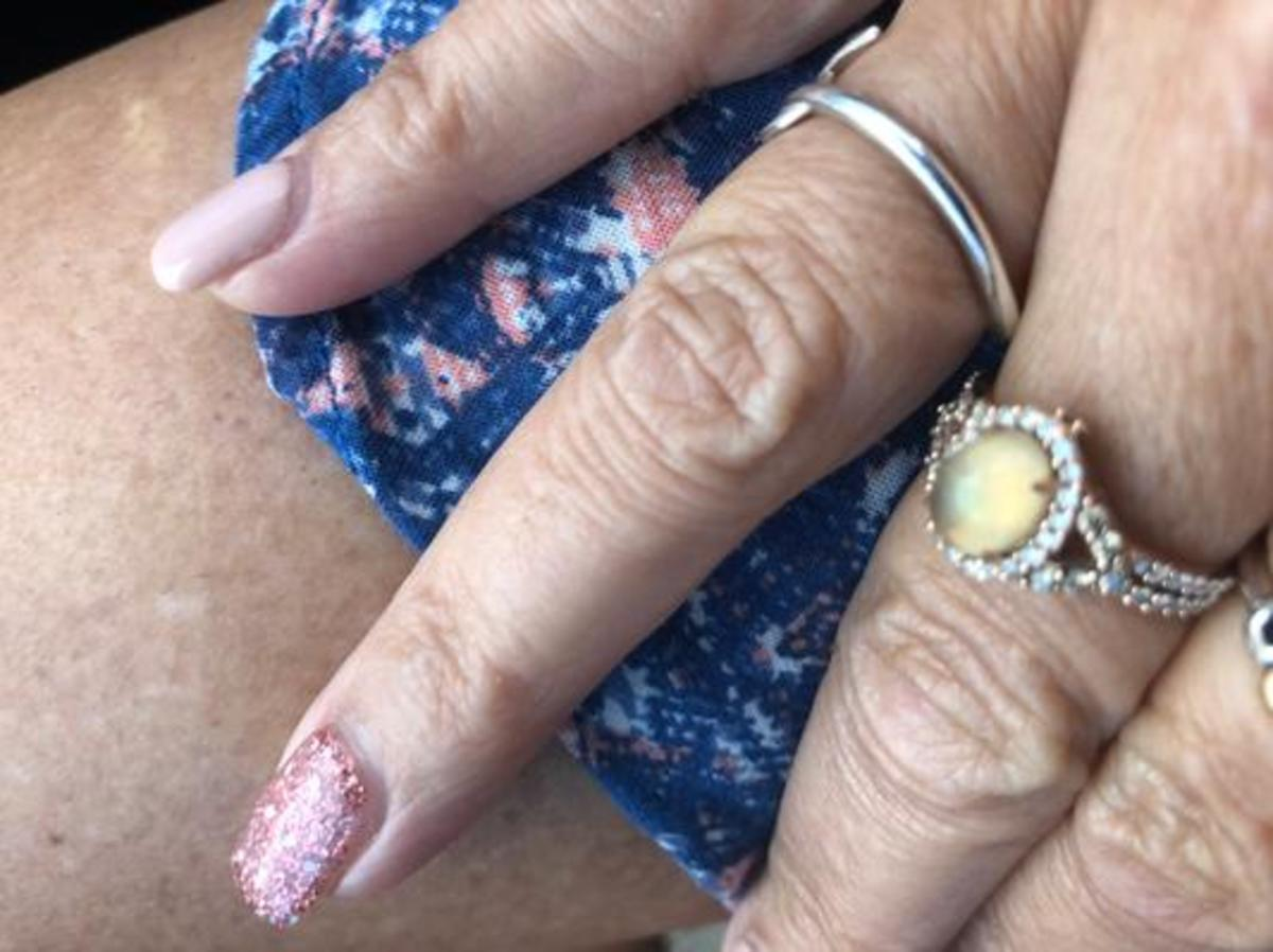 The image that the other disgruntled buyer added on the Jared website to show how the opal was dull and lackluster. It's a different style, but the same Neopolitan Opal from LeVian.