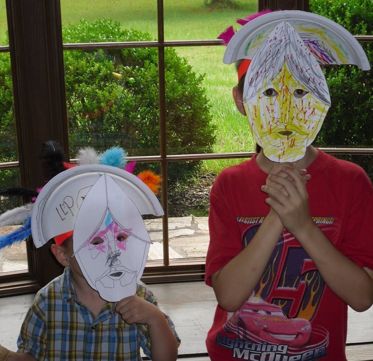 Creating Montezuma's headdress & Cortes Conquistador masks were two of the activities we did this week at home during our History Morning Basket & Activities time from the above link on Aztecs.