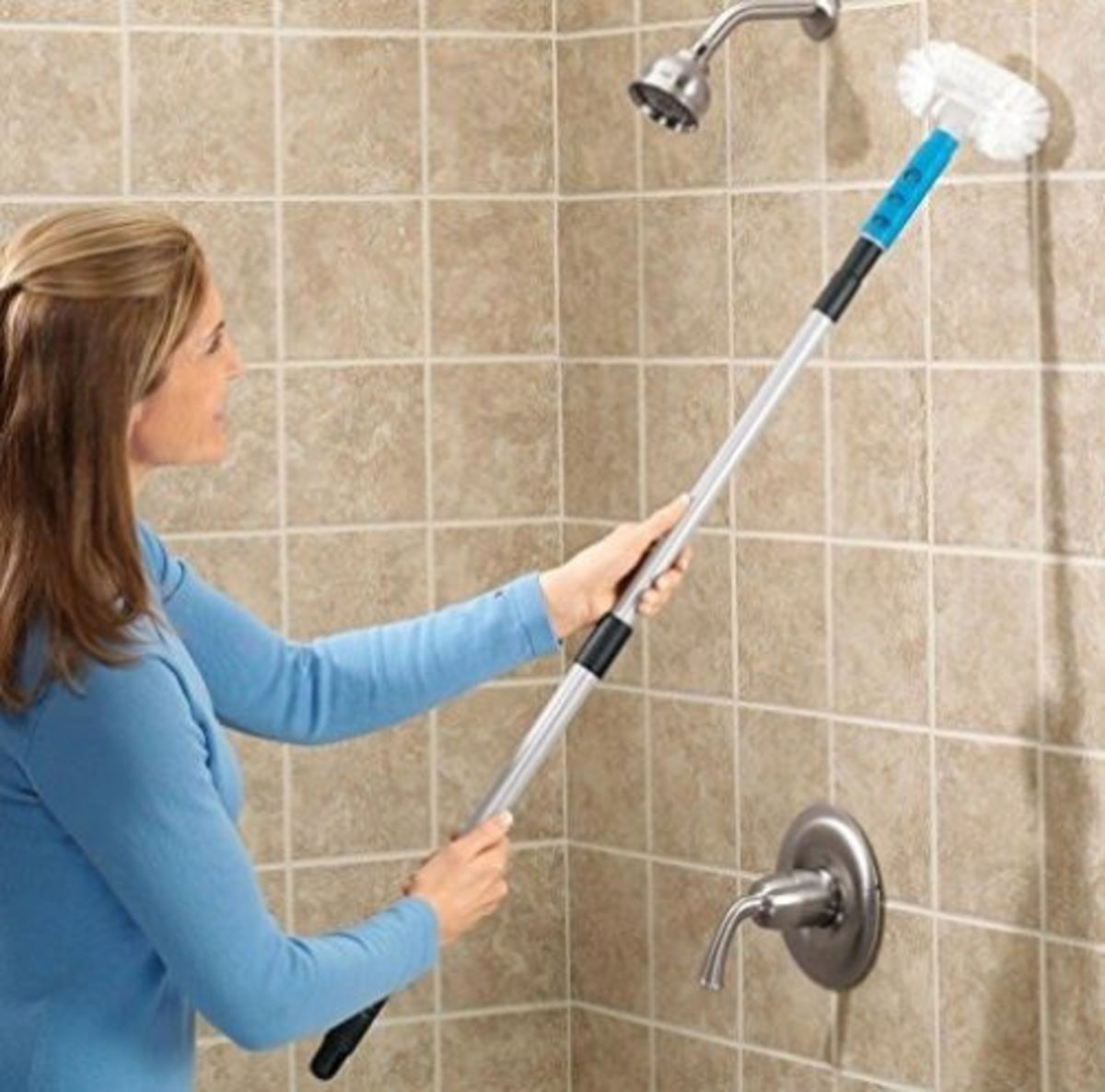 A telescopic bathroom tile scrub brush is easier and quicker to clean the shower stall.