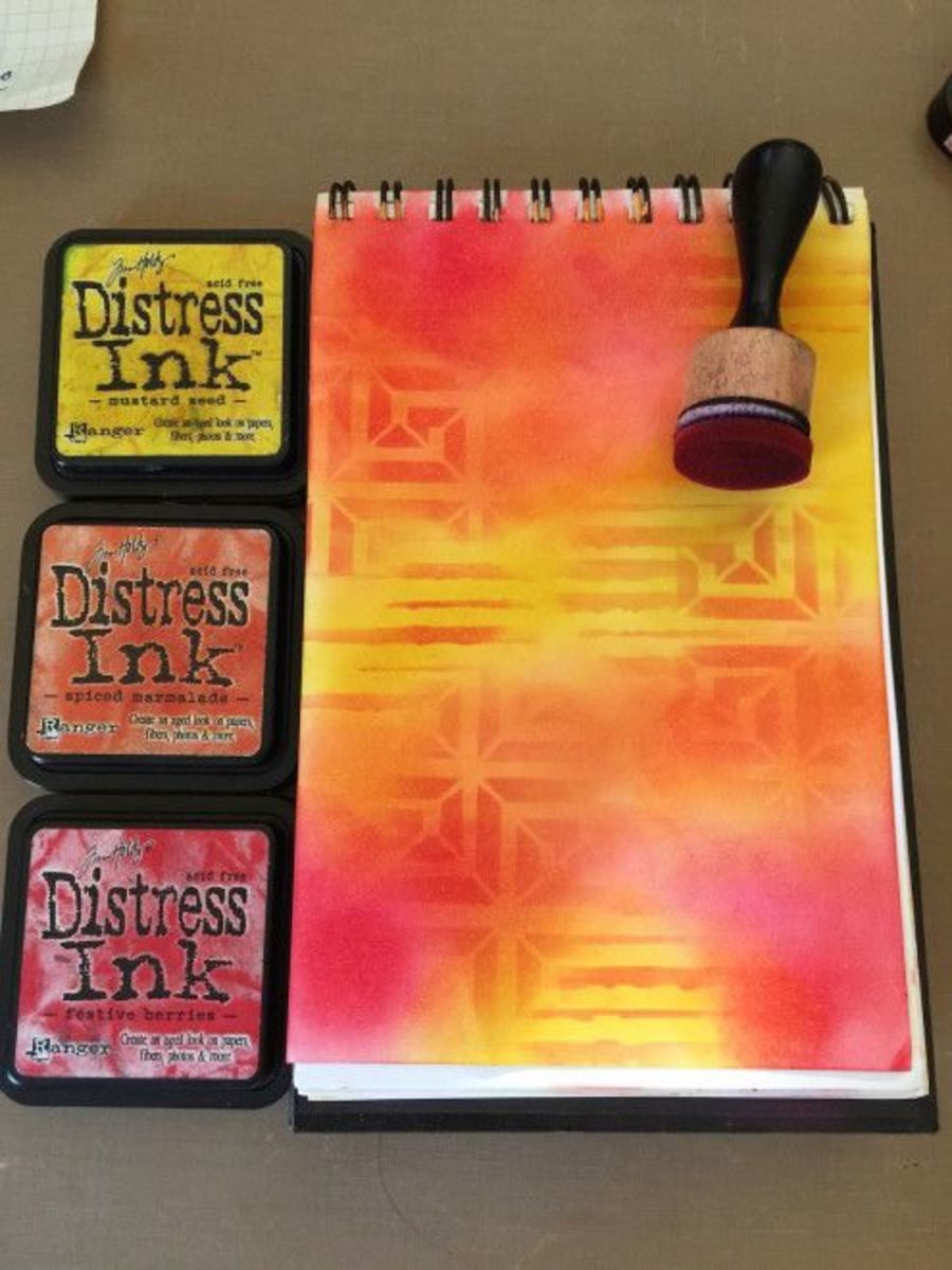 You can use distress inks and oxide inks to create unlimited color combinations in your art journal pages