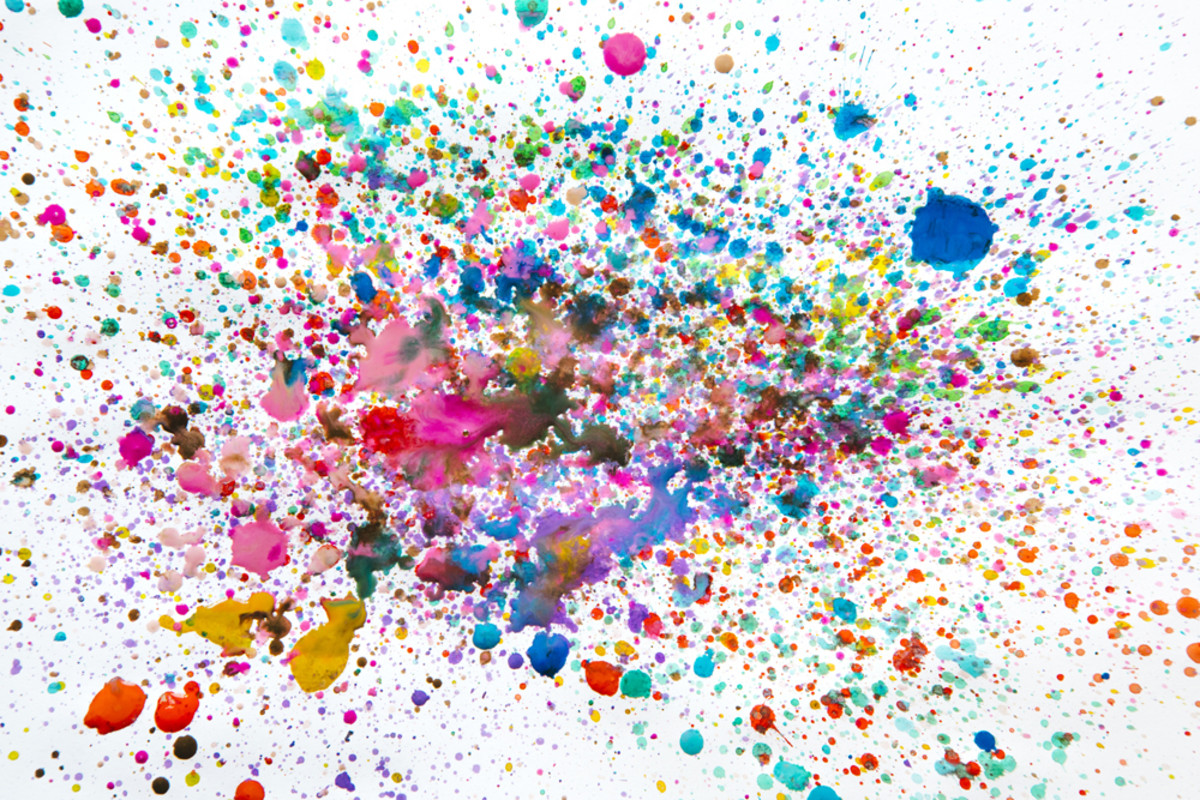 You can use one or multiple colors of inks to create an ink splatter for your art journal