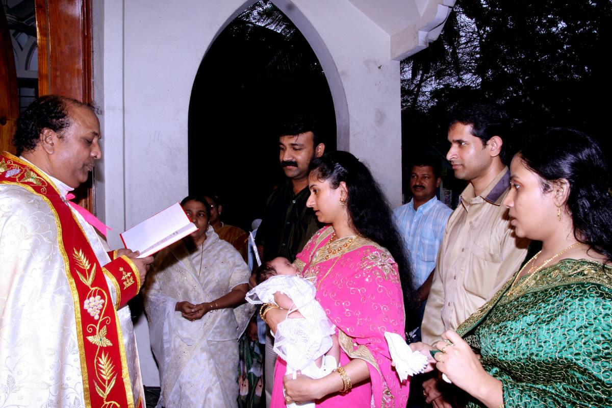Church , receiving the baby at the Main Door