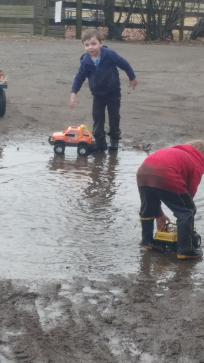 Nothing says farm kids like playing in mud puddles!