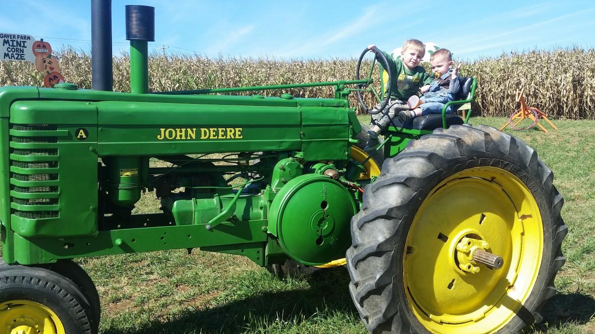 Farm  kids are born loving tractors!