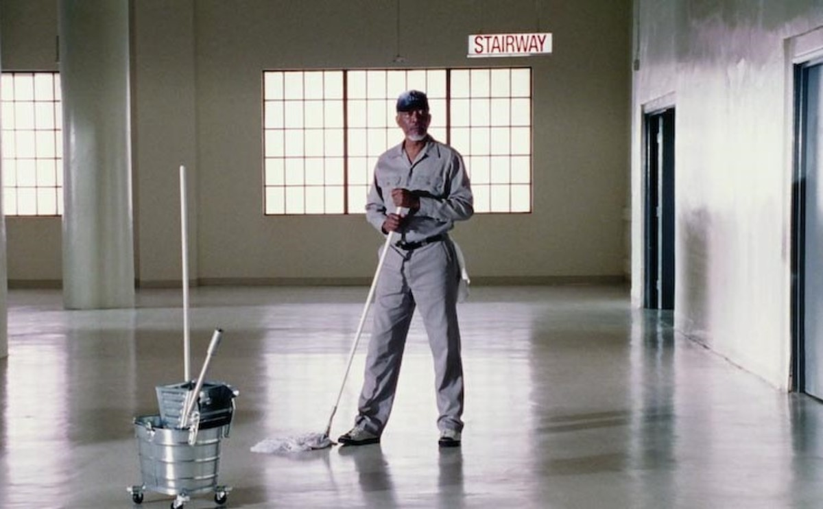 He is literally wearing a janitor's outfit.