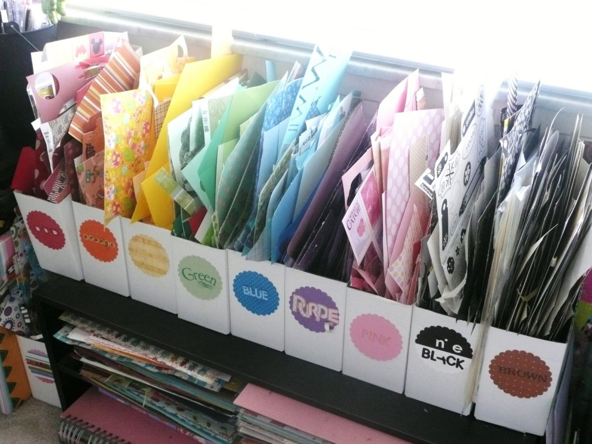 Magazine holders that are color coded are one way to hold your paper scraps- the great feature of this system is that you can see what you have and where it is.