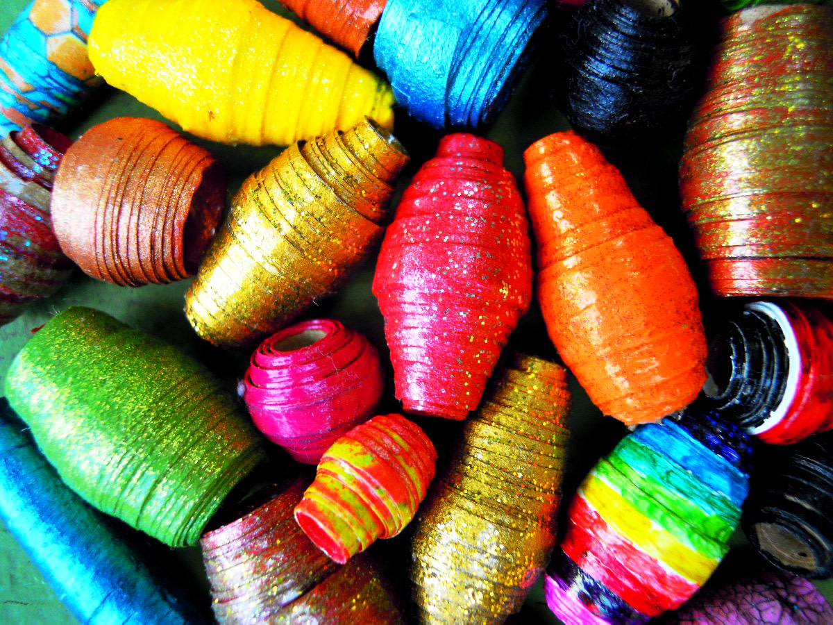 Paper beads are the perfect use for all your paper scraps. Even the tiniest scrap can be used to make a small bead