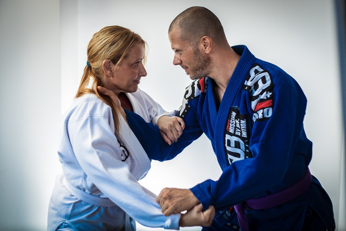 Jiu Jitsu primarily relies on grabbing and locking up or choking an opponent, in addition to various throws.
