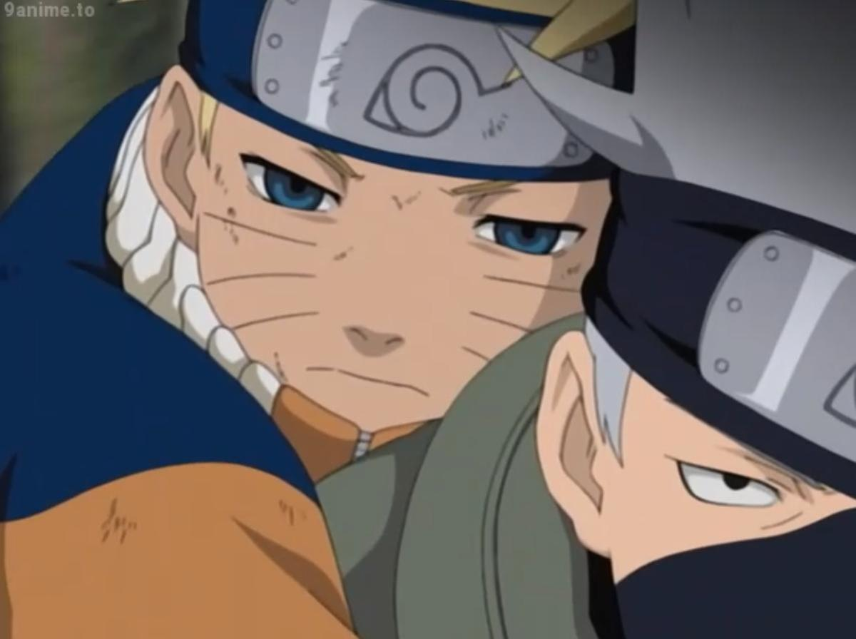 Kakashi carrying Naruto on his back after he was defeated by Sasuke at the Valley of the End.