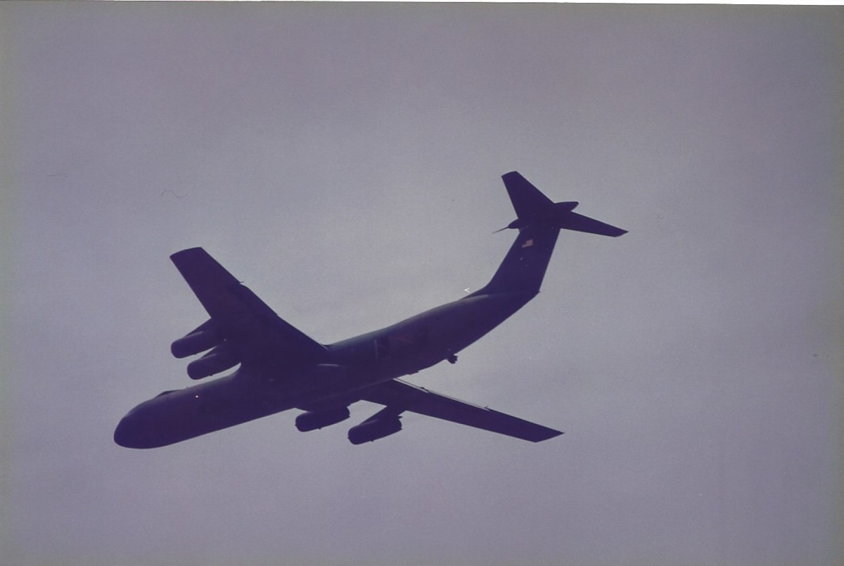 A C-141B over Joint Base Andrews, MD