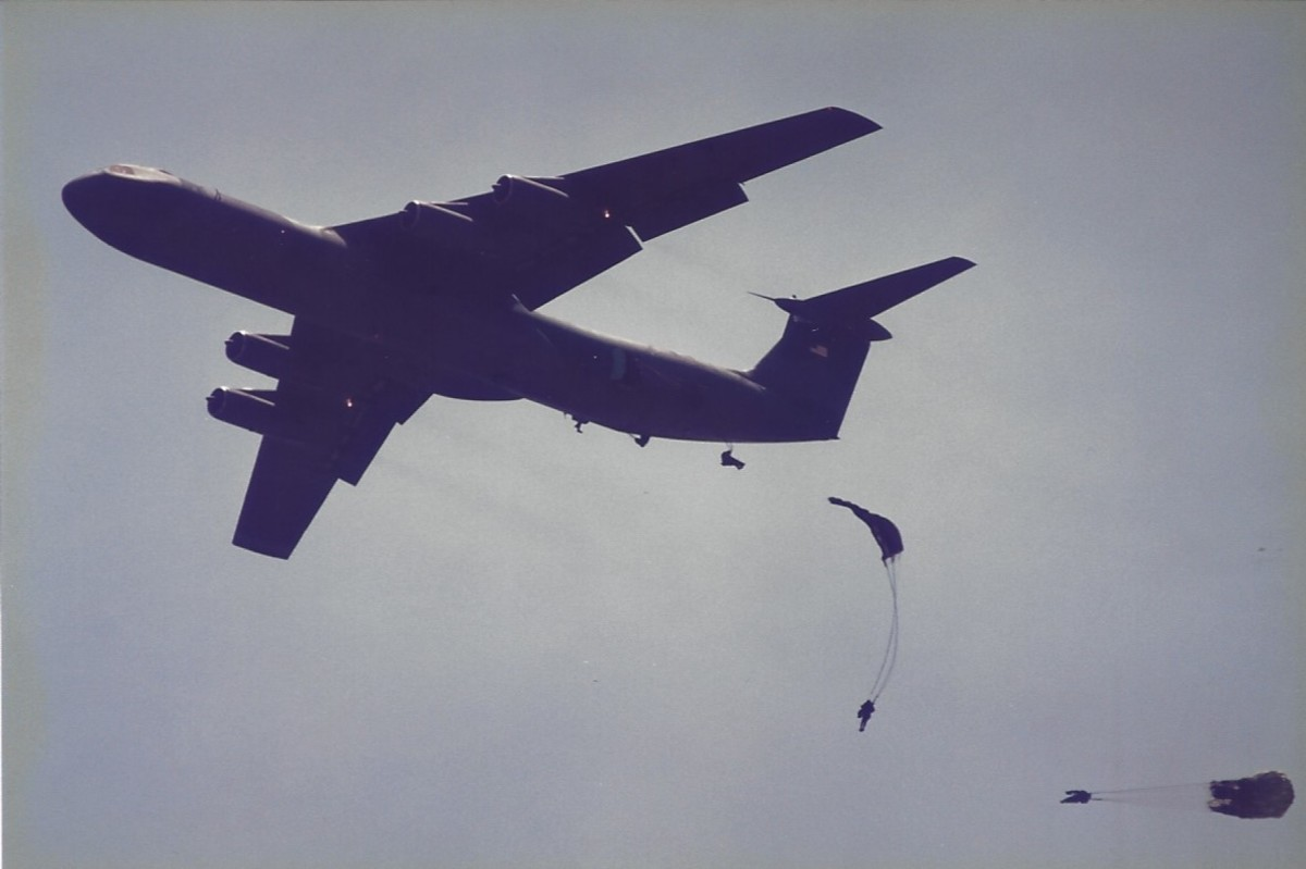 Paratroopers jumping out of a C-141B at Joint Base Andrews, MD.
