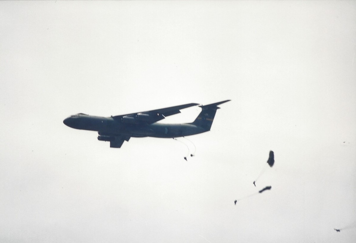 Paratroopers jumping out of a C-141B over Joint Base Andrews, MD.