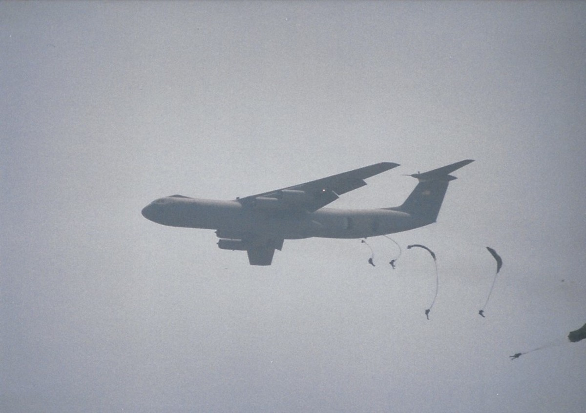 Paratroopers jumping from a C-141B, Joint Base Andrews, MD.