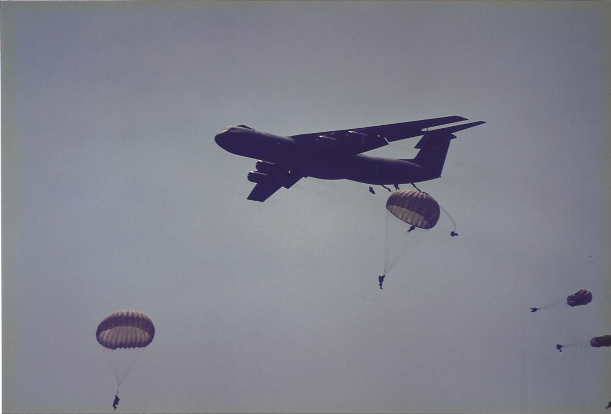Paratroopers jumping from C-141Bs at Joint Base Andrews, MD.