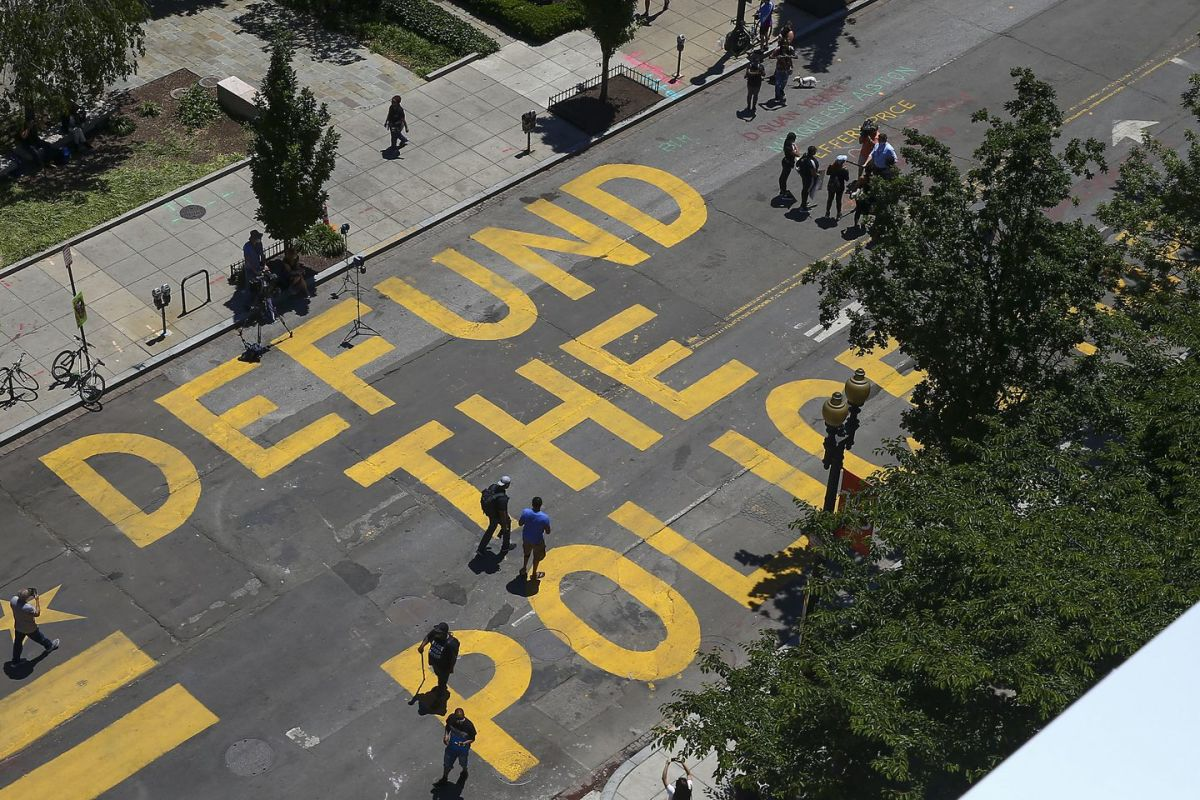 "The ""Defund the Police"" text on the street near the White House painted by Black Lives Matter activists"
