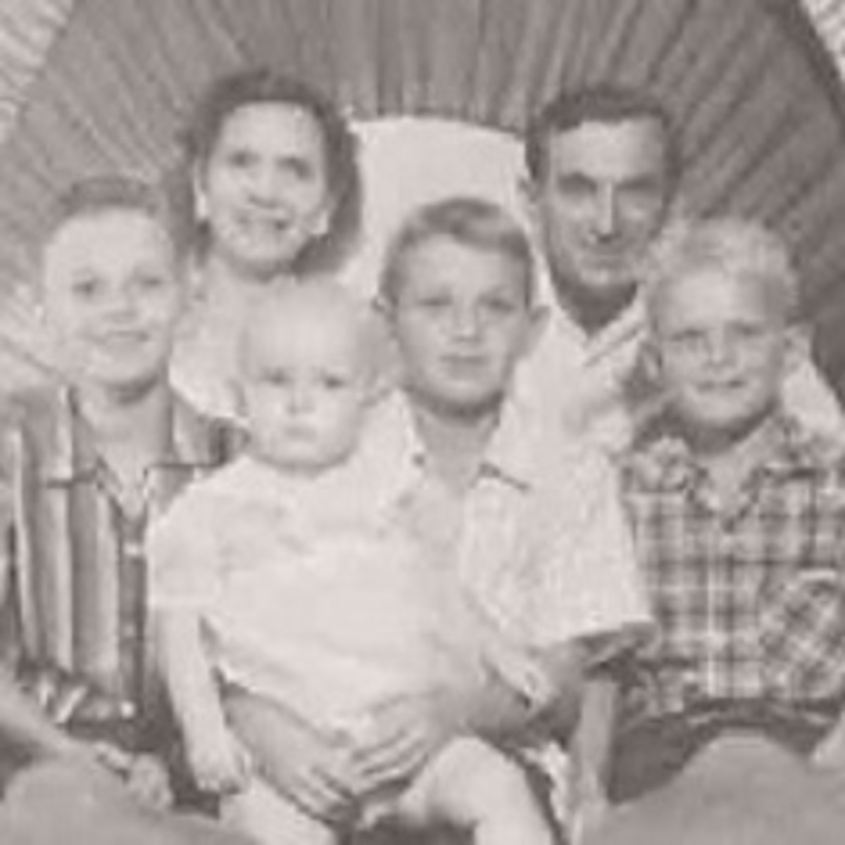 Mom and Dad, Dale, Paul holding me and Jimmy