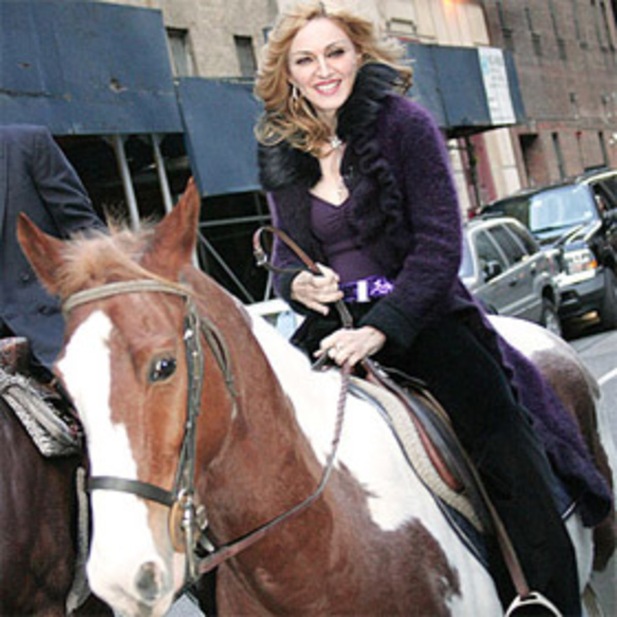 Madonna rides a horse in what appears to be New York