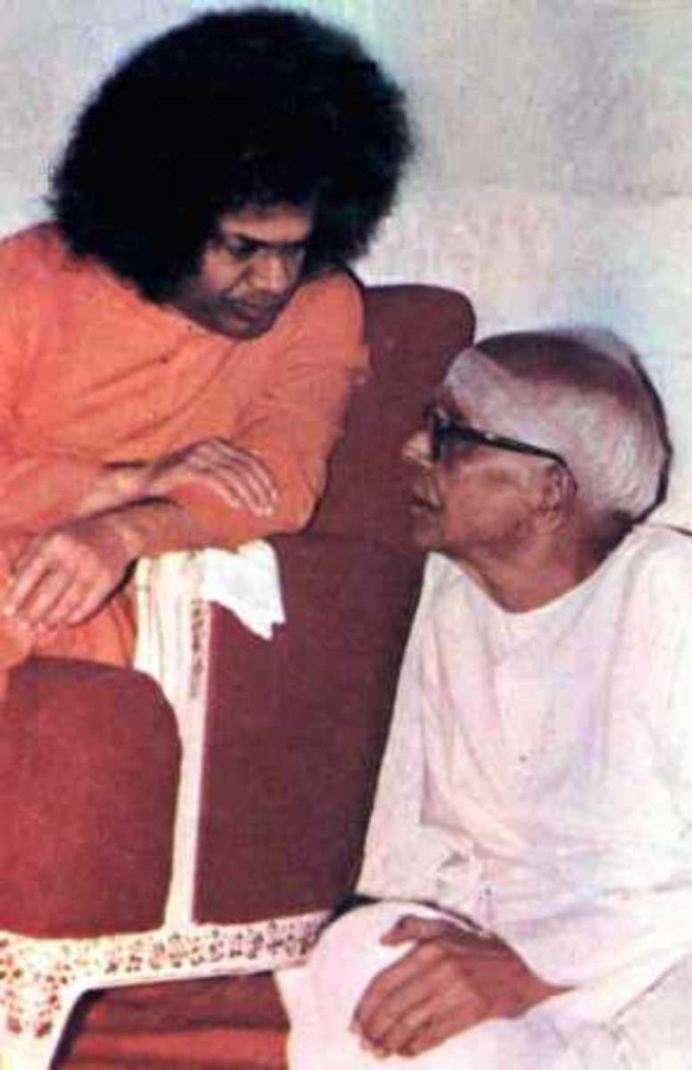 Swami sharing an intimate moment with Sri Kasturi