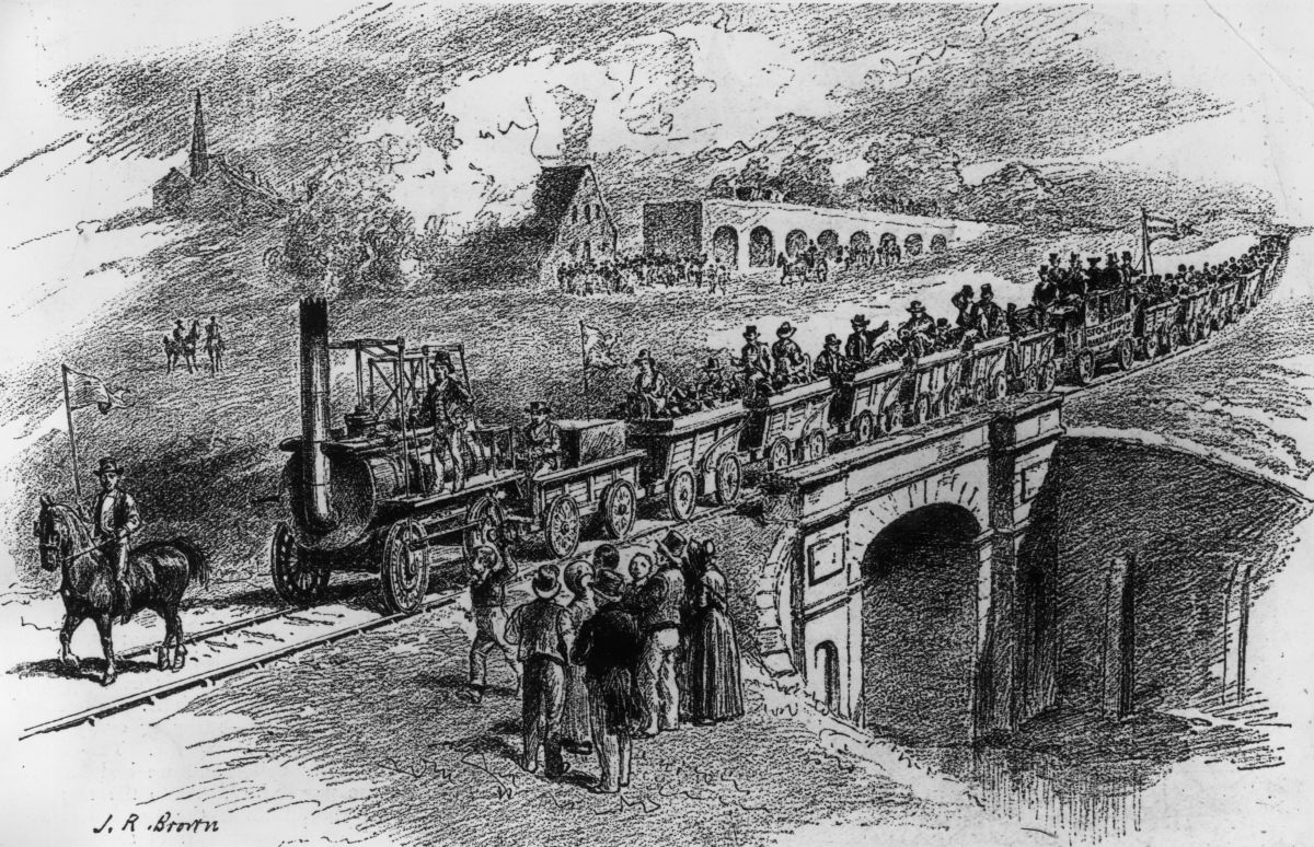 Skerne Bridge near North Road Station, Darlington seen from the north side, with the inaugural train from Shildon driven by George Stephenson. The bridge appeared on the previous £5 note behind the portrait of the great  man