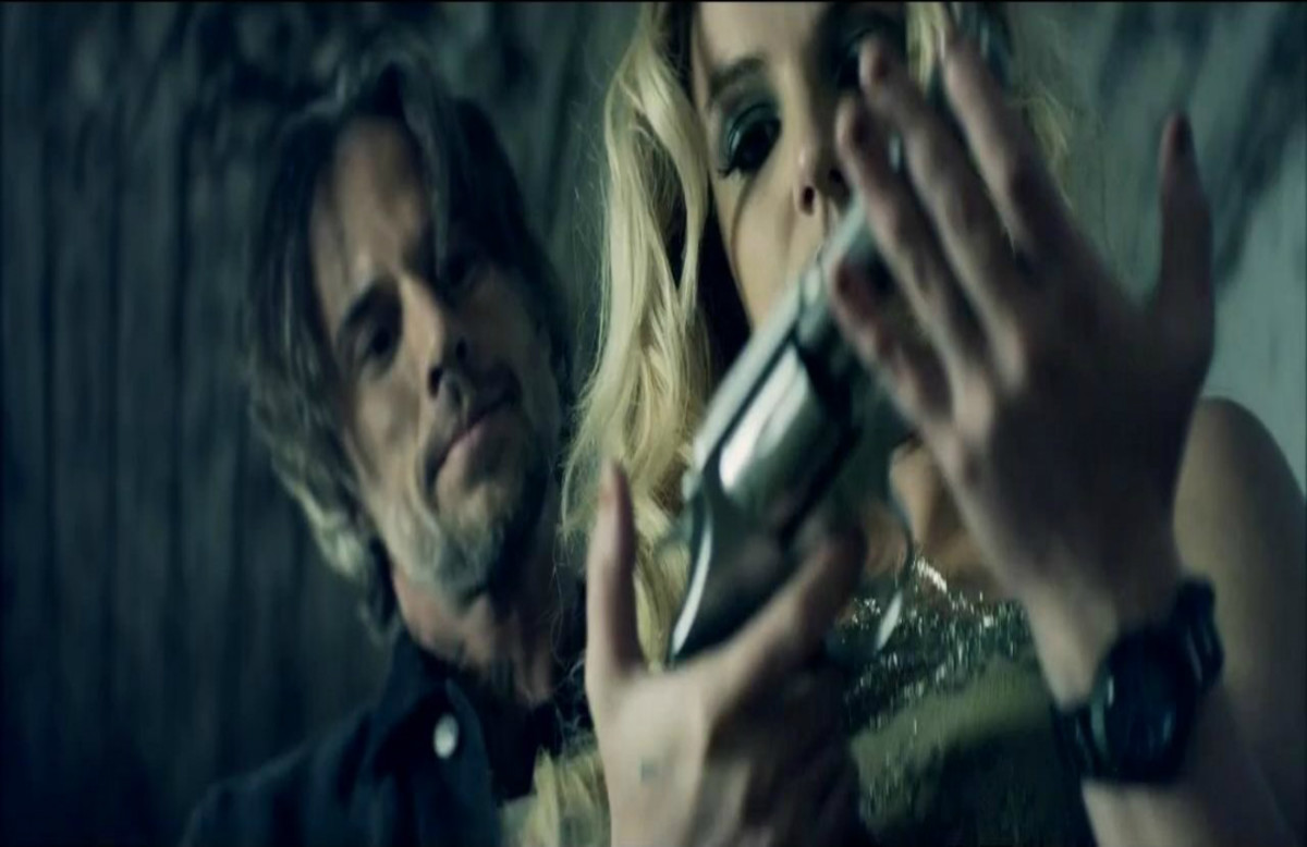 In the aftermath of riots in London, Britney Spears shot er music video there and received criticisms for gripping a gun which is said to glamorize violence.