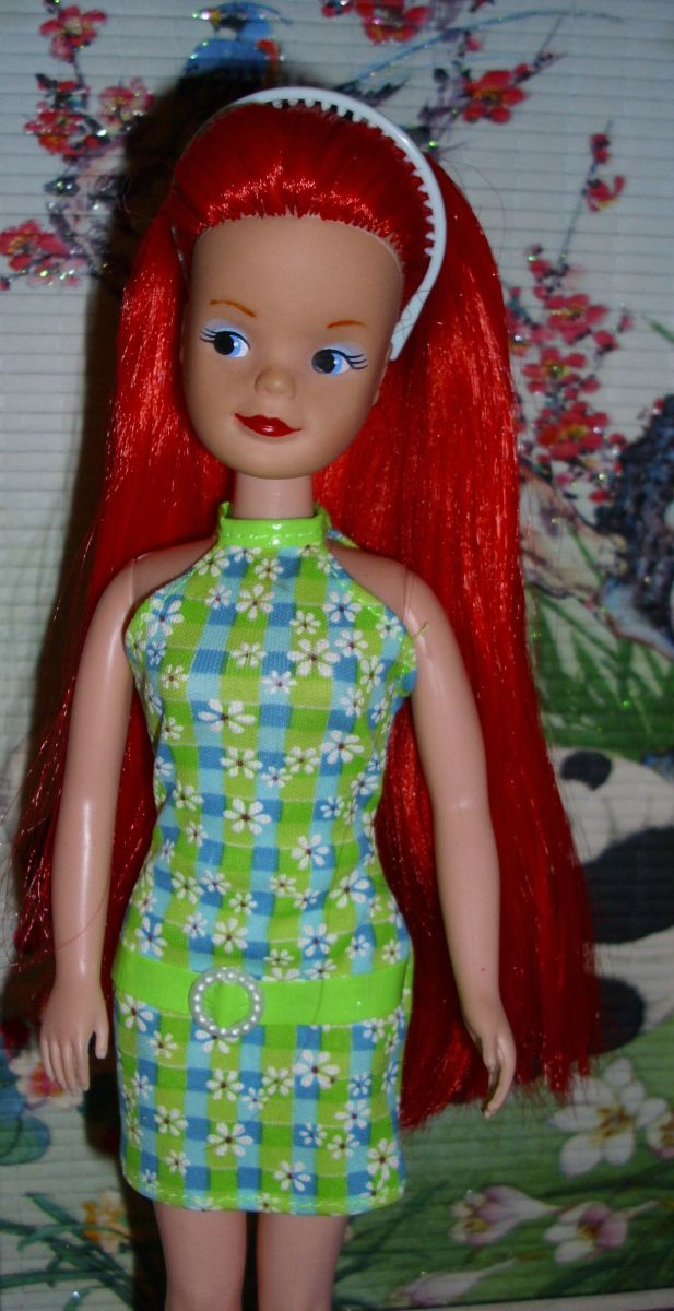 Hasbro Sindy re-root in Pillarbox Red Saran She's also had her lips & Eyebrows repainted.