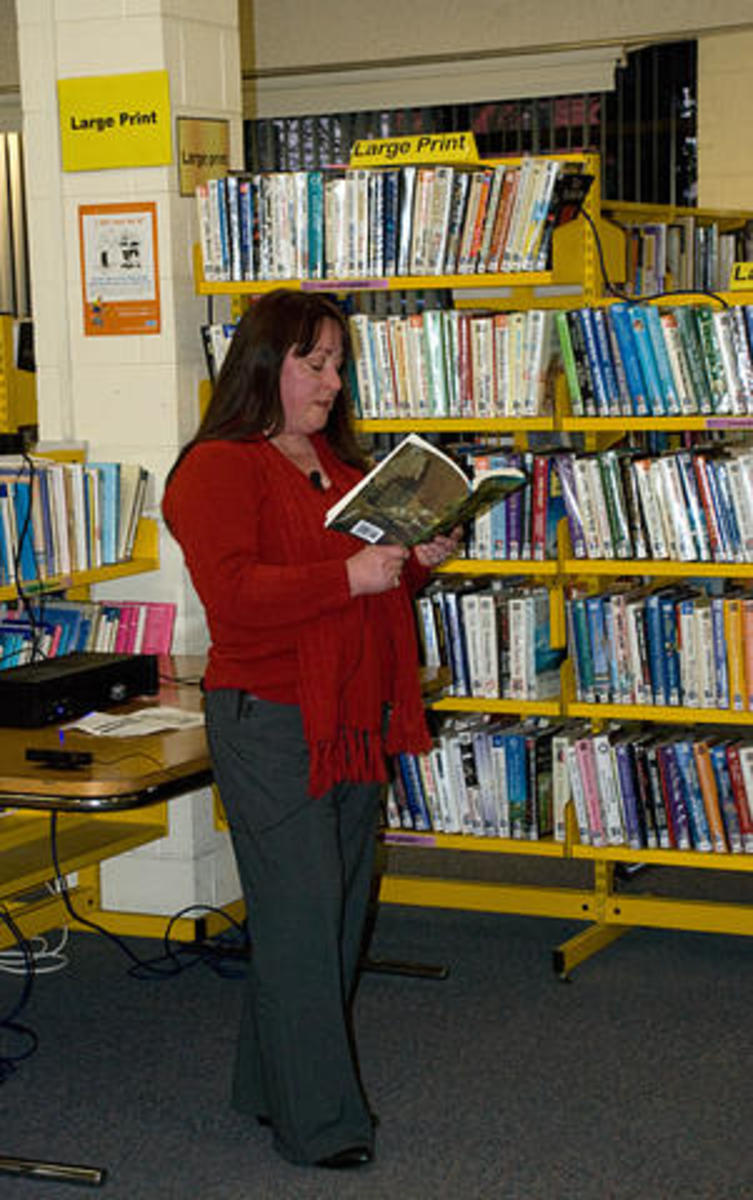 """Photo from """"Words from Wordsmiths"""" showing Adele Cosgrove-Bray reading her ghost story, """"Seagull Inn"""", from the anthology """"Ruins Terra."""""""